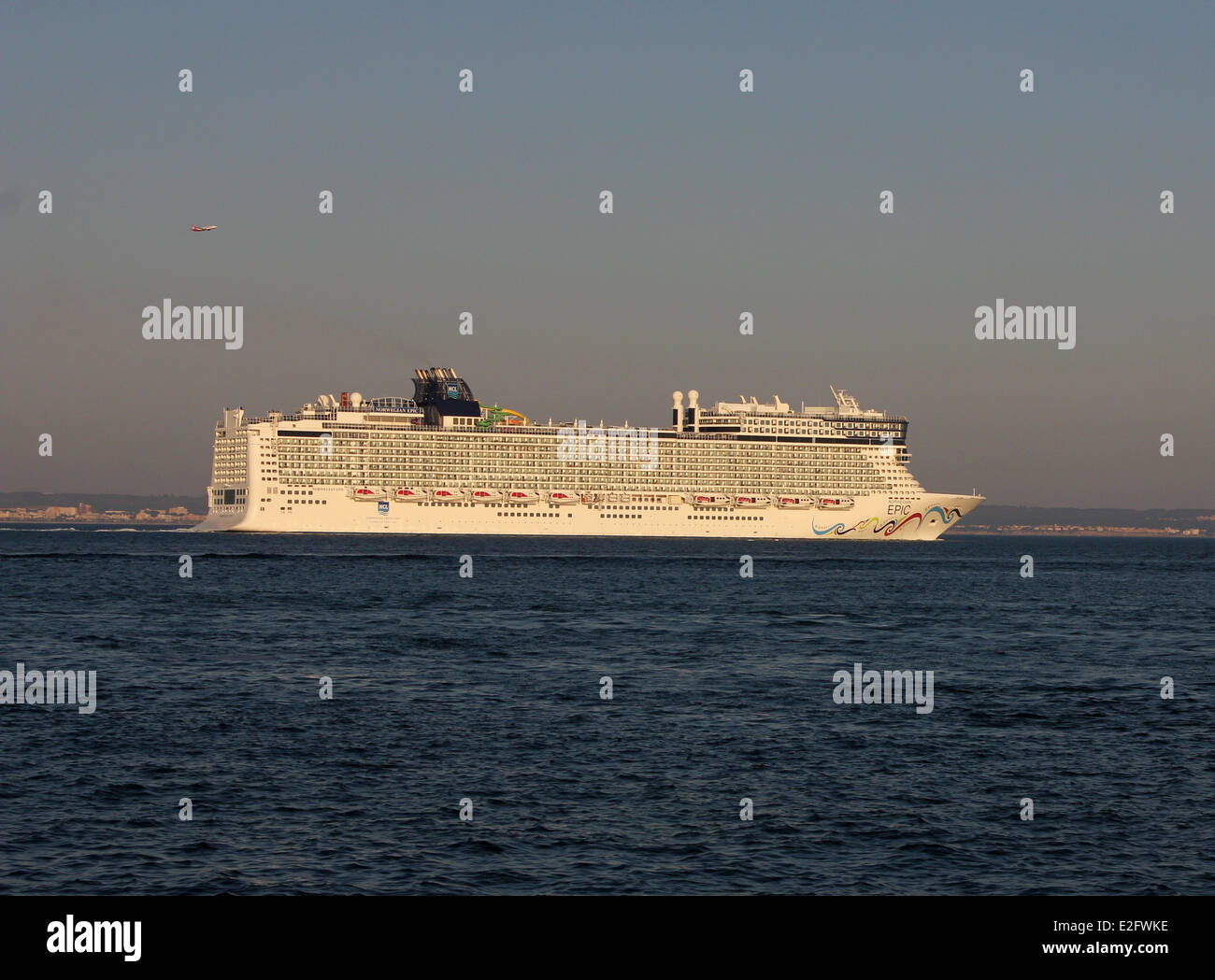 "Norwegian Cruise Line (NCL) Cruise ship ""Norwegian Epic"" (325 mtrs) - departing port at late afternoon - Port of - Stock Image"