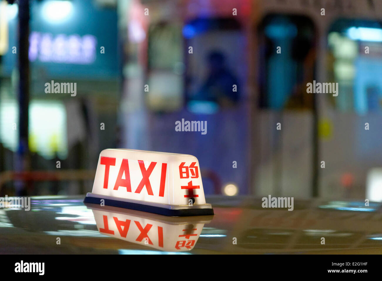 China Hong Kong Hong Kong Island District of Exchange District sign of taxi switched on of night - Stock Image