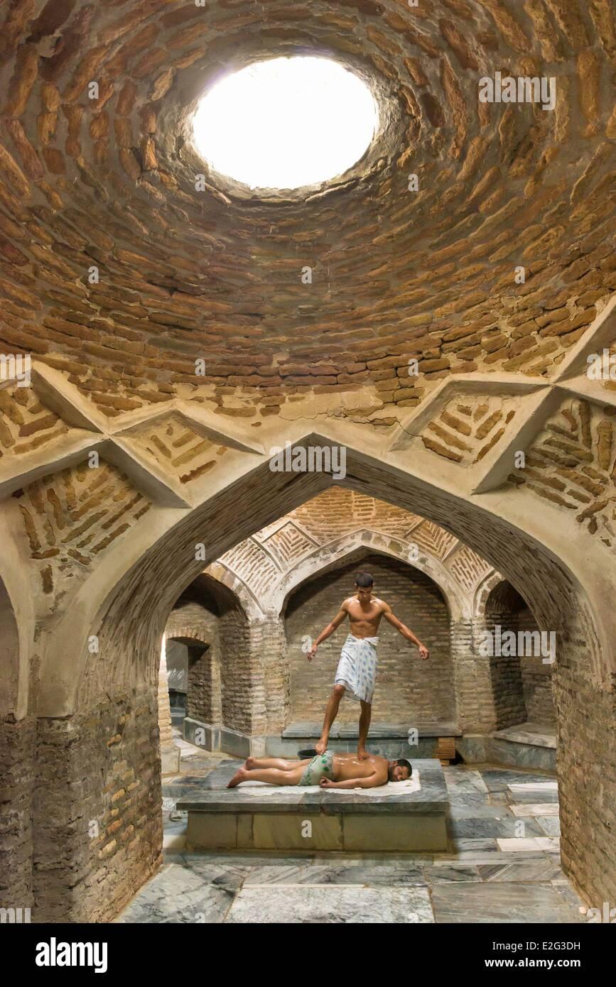 Uzbekistan Silk Road Bukhara historical center listed as World Heritage by UNESCO massage in historic hammam Bozori - Stock Image