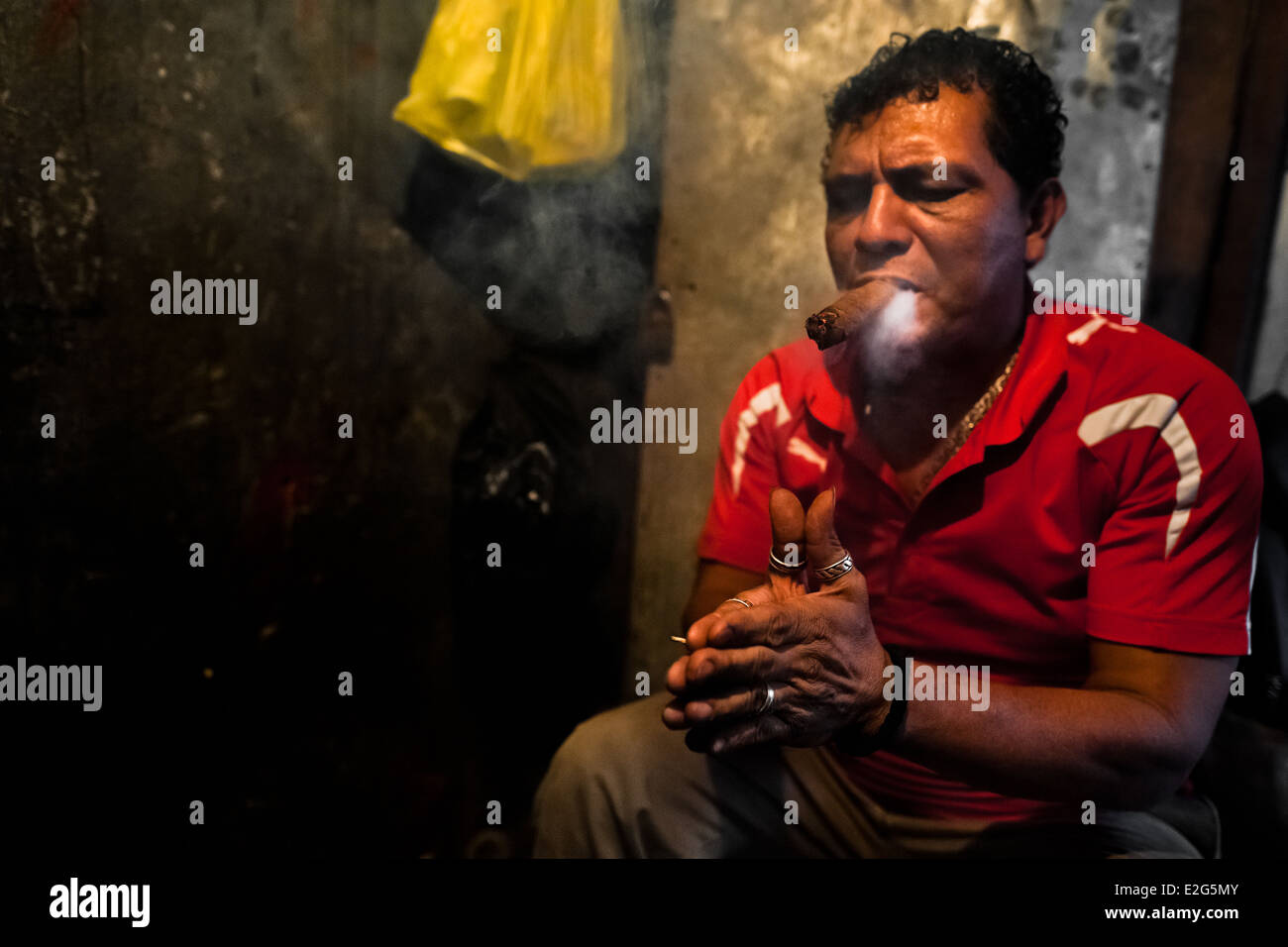A Salvadorean 'brujo' (sorcerer) predicts the future from burn tobacco leaves in a street fortune telling shop in - Stock Image