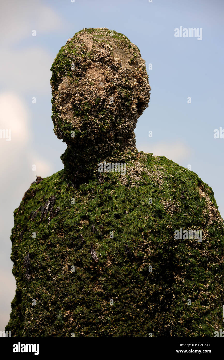 Another Place,artistic installation,Anthony Gormley statues on Crosby beach - Stock Image