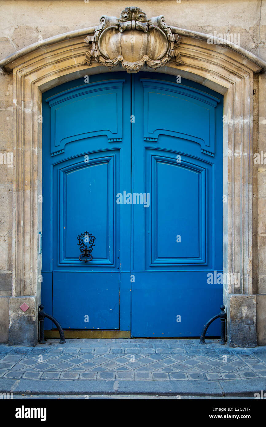 Ornate wooden doors in the Marais district, Paris France - Stock Image