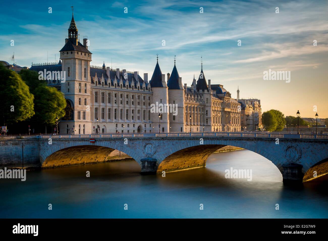 The Conciergerie, Pont au Change and River Seine, Paris France - Stock Image