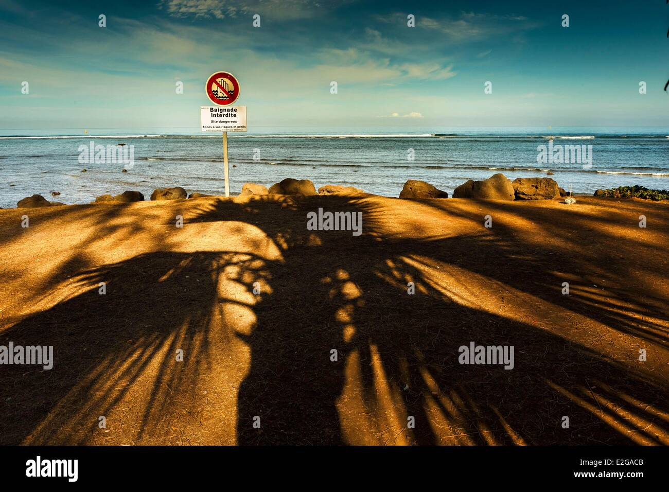 France Ile de la Reunion (French overseas department) Saint Leu shadows of palm trees on the waterfront prohibits - Stock Image