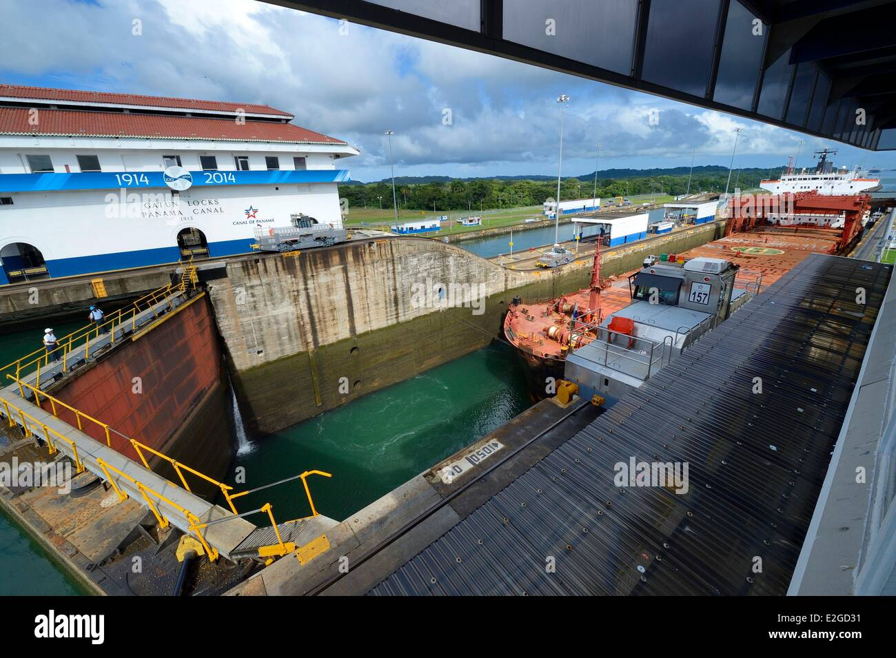 Panama Colon province Panama Canal Gatun locks mechanical mules or electric locomotives guiding a Panamax cargo - Stock Image