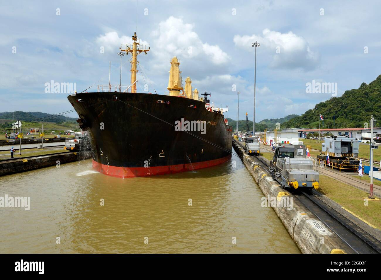 Panama Panama Canal Pedro Miguel locks mechanical mules or electric locomotives guiding a Panamax cargo between - Stock Image