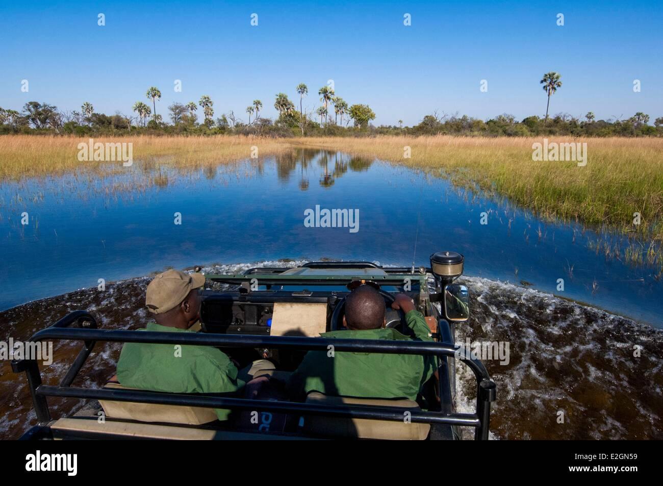 Botswana North West District Okavango Delta Abu Lodge crossing of swamps with 4x4 - Stock Image