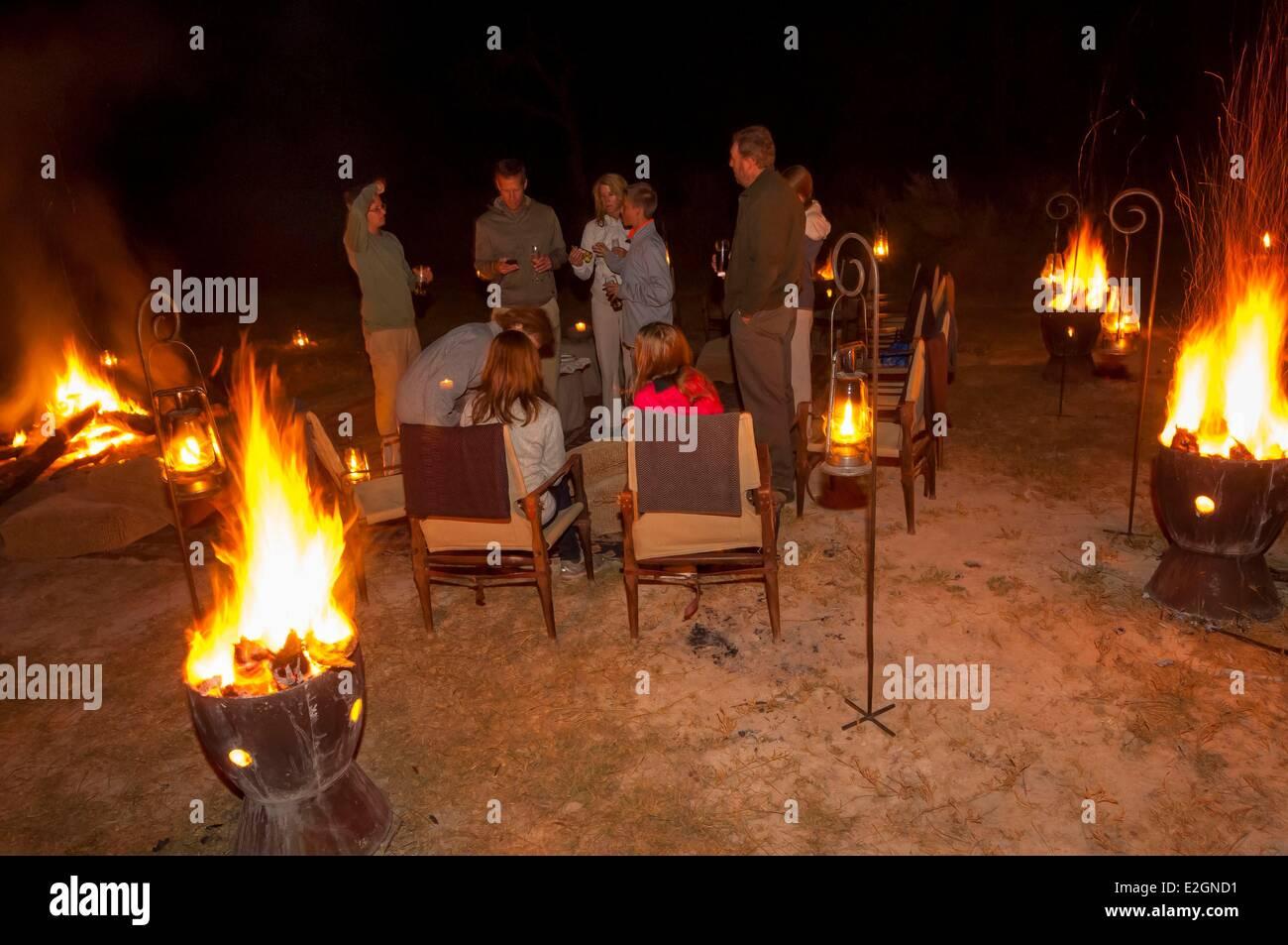 Botswana North West District Okavango Delta Abu Lodge diner lit by torches in bush - Stock Image