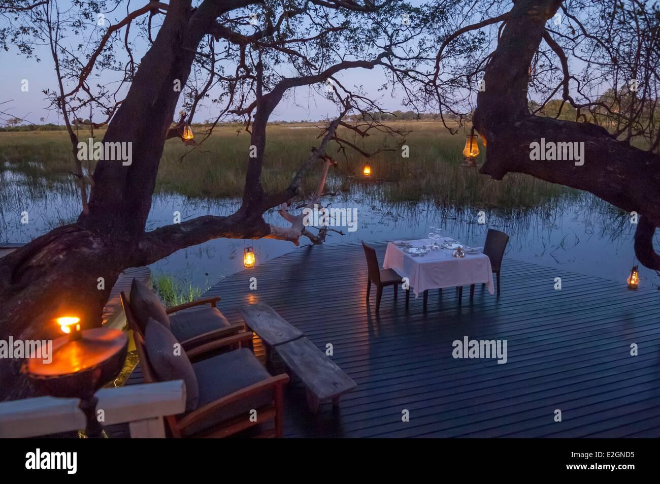 Botswana North West District Okavango Delta Abu Lodge deck reception lounges and outdoor restaurant - Stock Image