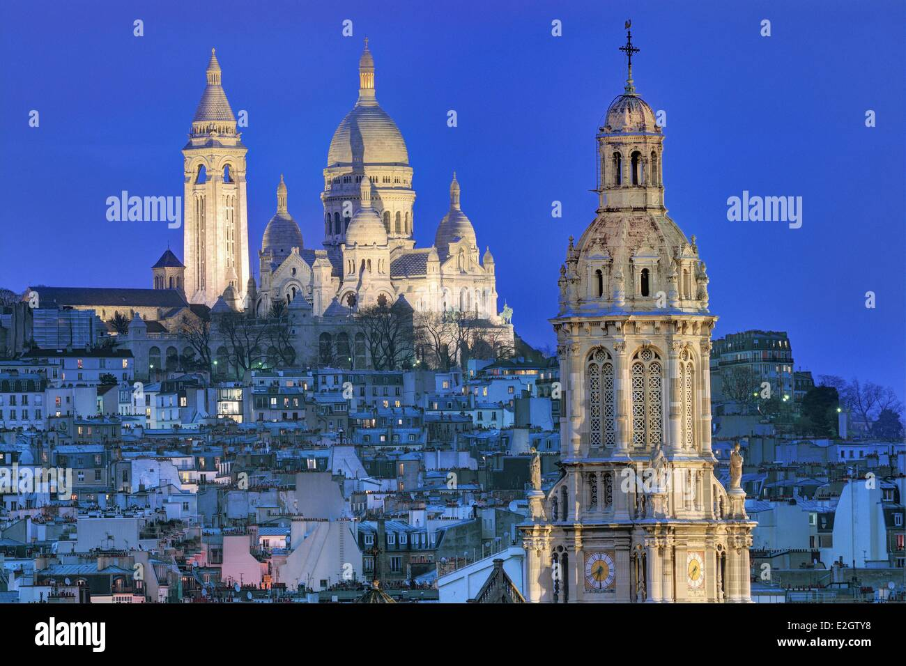 France Paris basilica of Sacre-Coeur of Montmartre and bell-tower of Sainte-Trinite (Holy Trinity) church - Stock Image