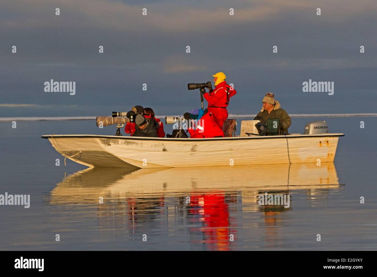 United States Alaska Arctic National Wildlife Refuge Kaktovik frozen lagoon and sea pack ice formation boat with Stock Photo