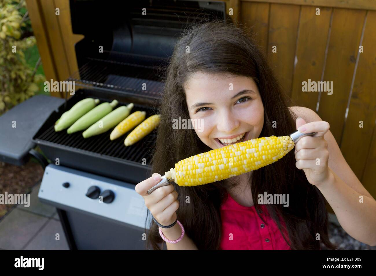 Canada Quebec province Montreal tasting sweet corn cooked on a barbecue Epluchette tradition - Stock Image