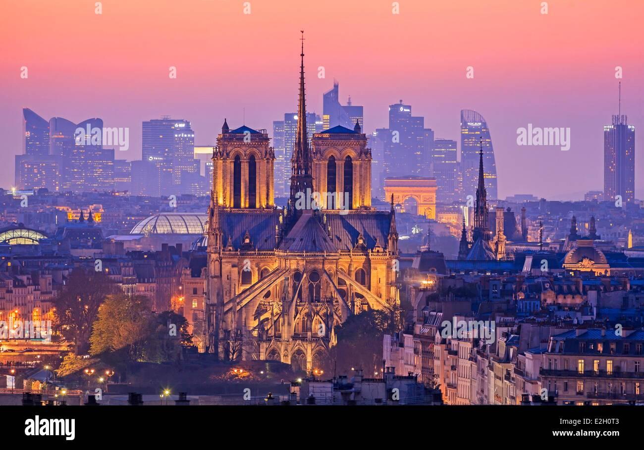 France Paris Notre Dame cathedral on Ile de la Cite with Arc de Triomphe and skyscrapers of La Dedense business - Stock Image