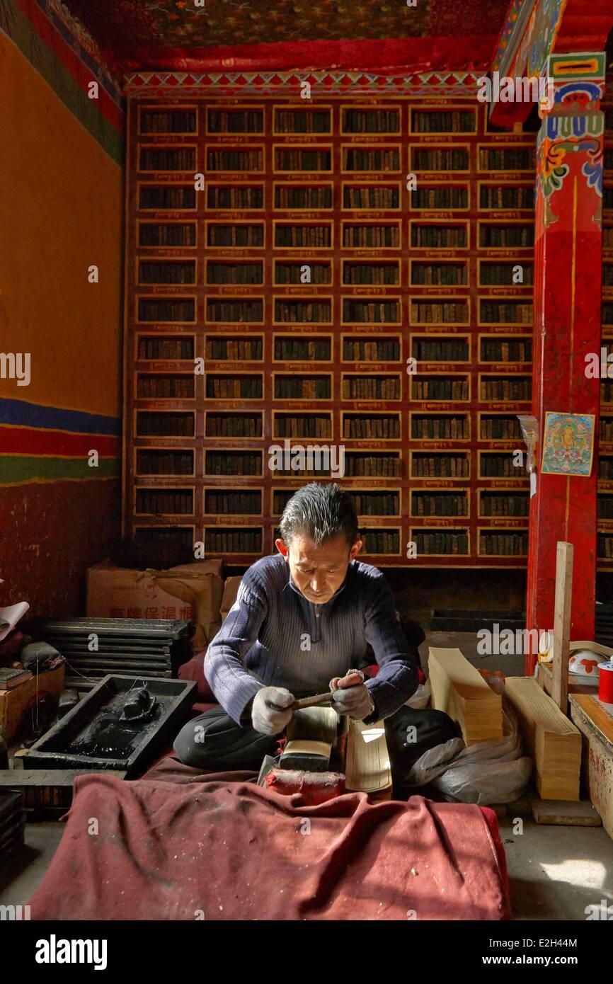 China Tibet Lhassa monk printing a holy book at Sera monastery - Stock Image