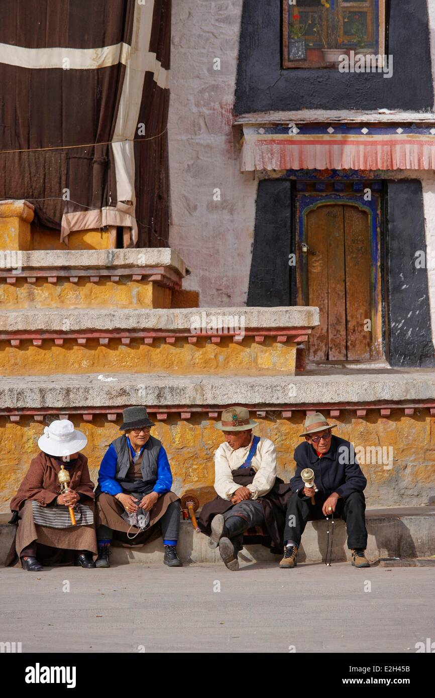 China Tibet Lhassa Pilgrims sitting in front of Jokhang temple this monastery is first Buddhist monastery build - Stock Image