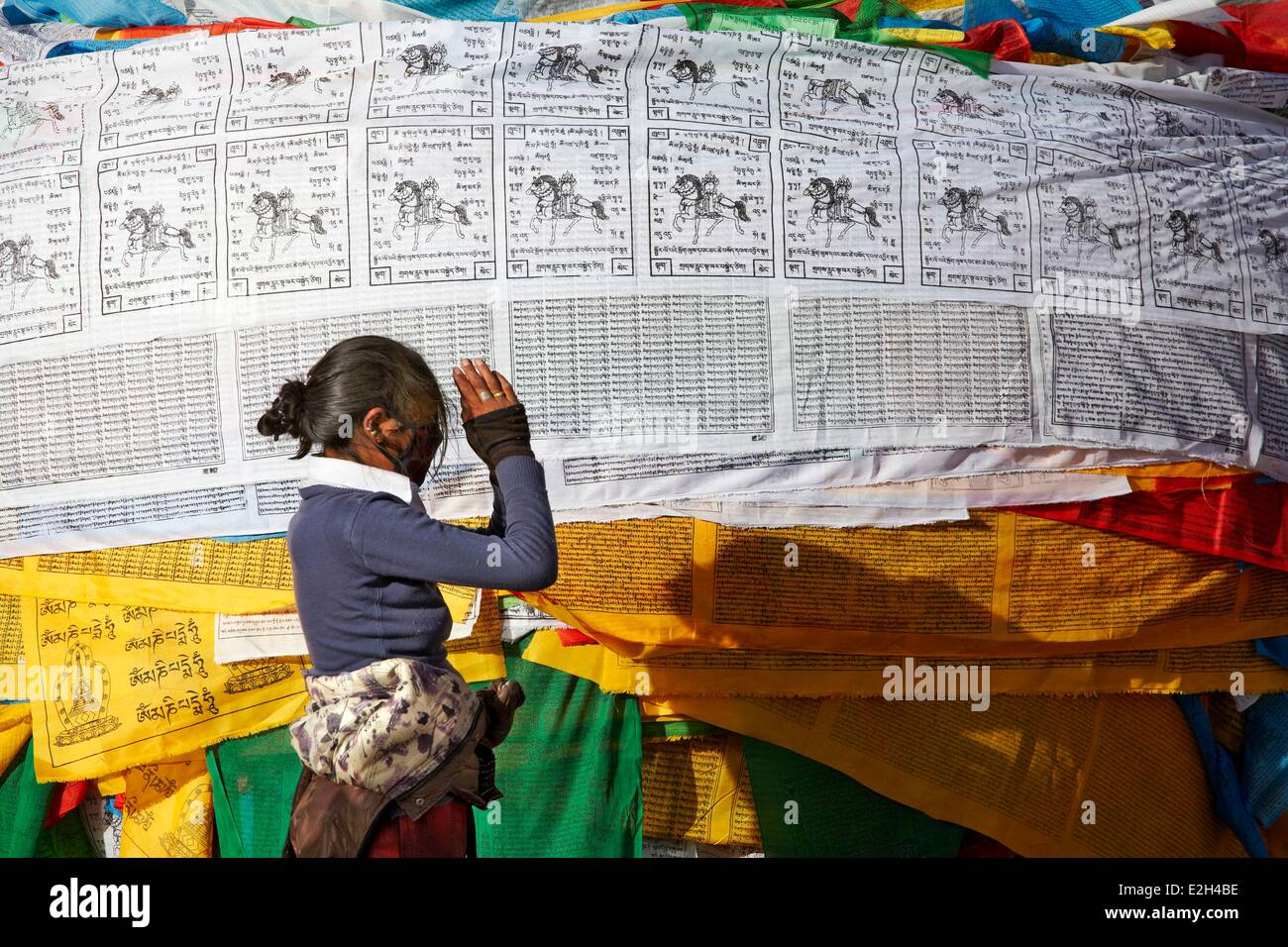 China Tibet Lhassa Pilgrim praying in front of Jokhang temple this monastery is first Buddhist monastery build in - Stock Image