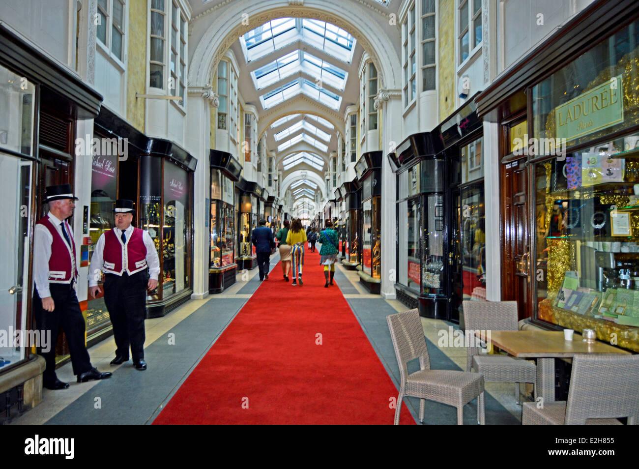 Burlington Arcade Beadles in traditional uniforms wearing top hats, Burlington Arcade, Mayfair, London, England, - Stock Image