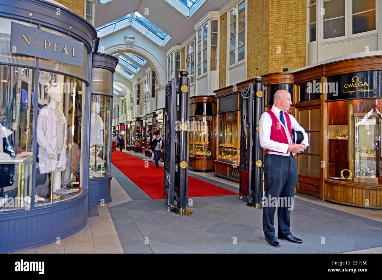 Burlington Arcade Beadle in traditional uniform at entrance of the Burlington Arcade, Mayfair, London, England, - Stock Image