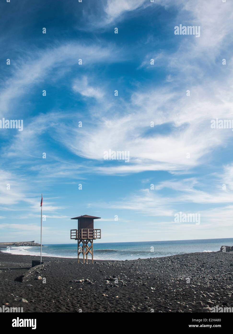 Watch tower on the beach, red flag, Tazacorte, La Palma, Canary Islands, Spain - Stock Image