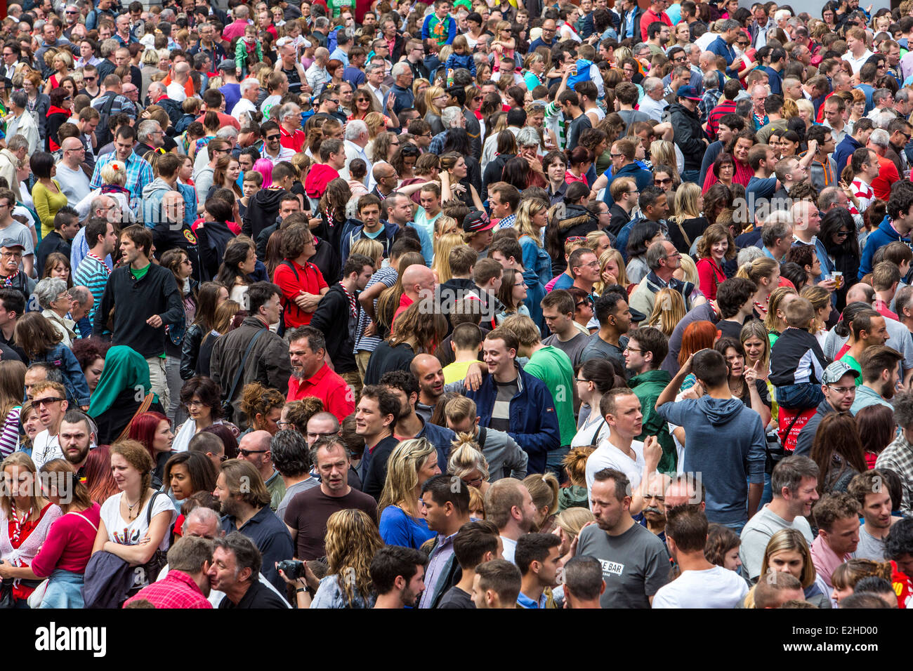 Crowd, many people in confined space, at a festival, - Stock Image