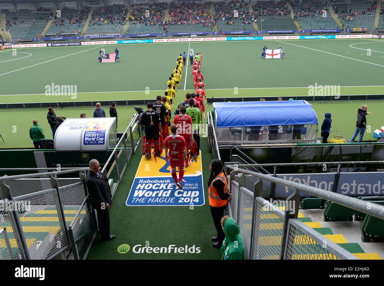 England's players line the tunnel before their match against Malaysia during their pool A game at the Rabobank - Stock Image