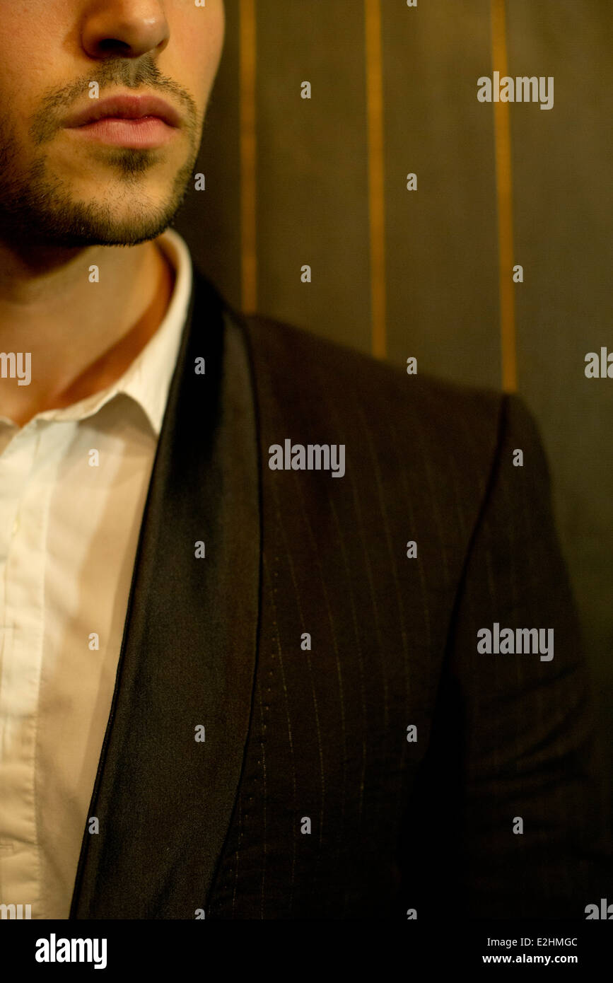Man in suit, obscured face Stock Photo
