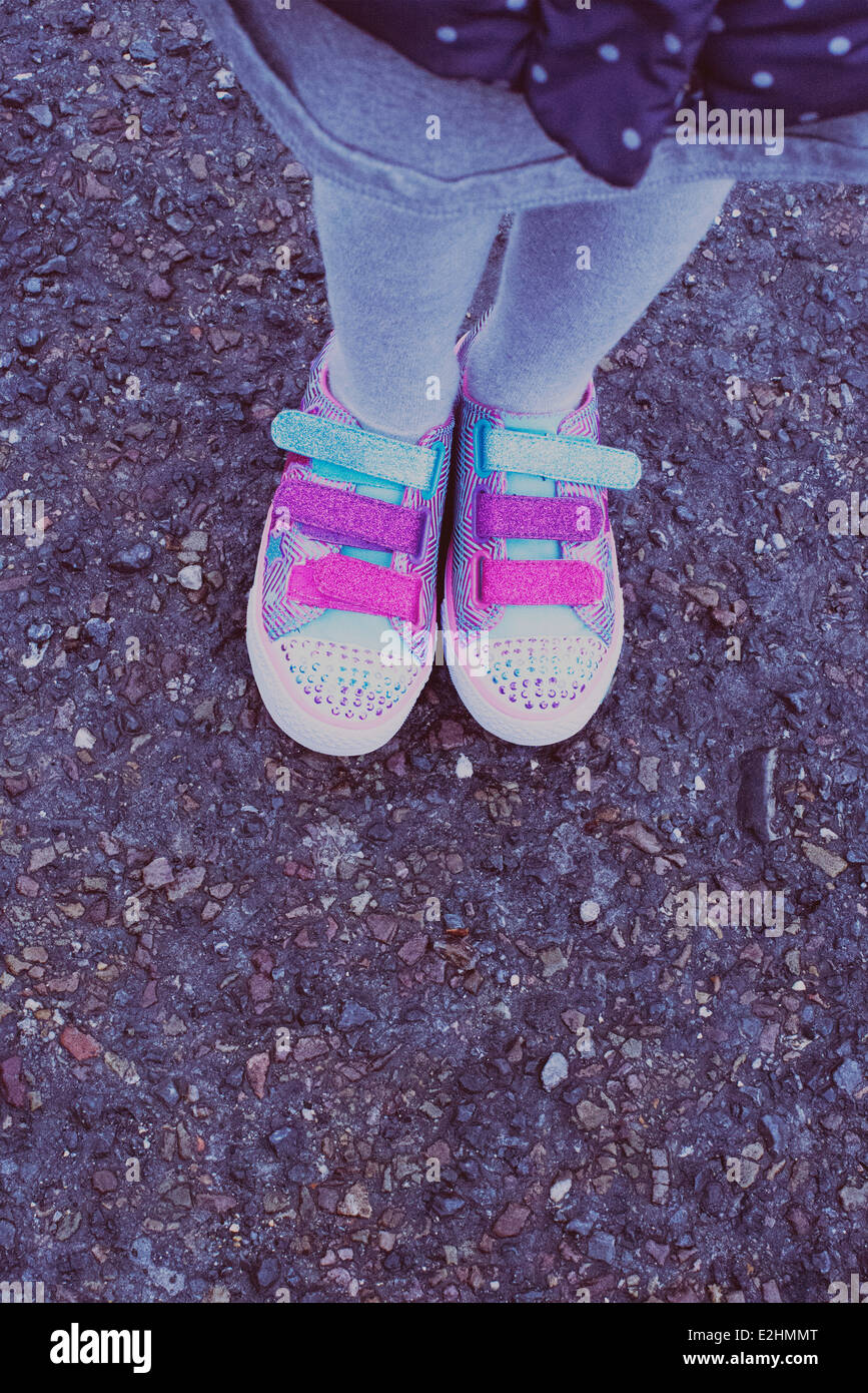 Girl wearing colorful sneakers, low section - Stock Image