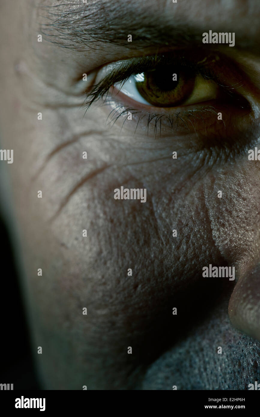 Mature man's eye, close-up - Stock Image