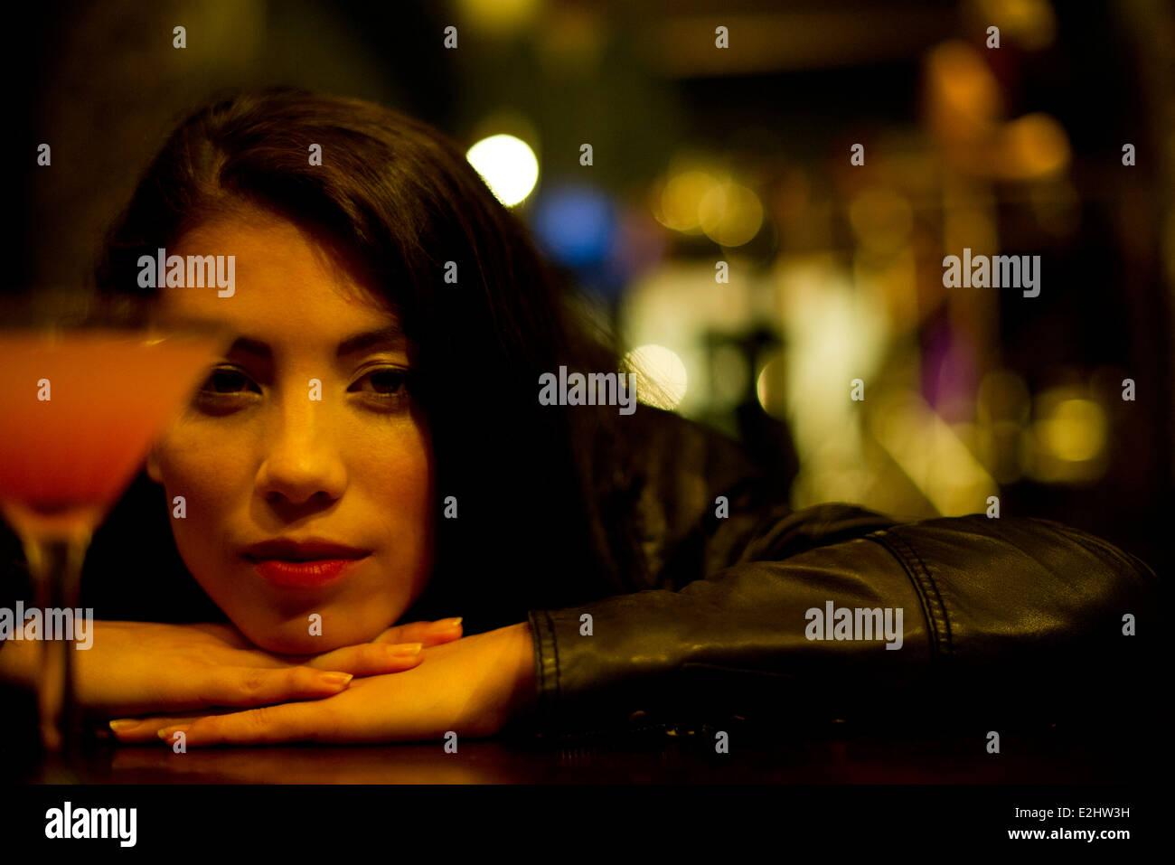 Woman drinking alone - Stock Image