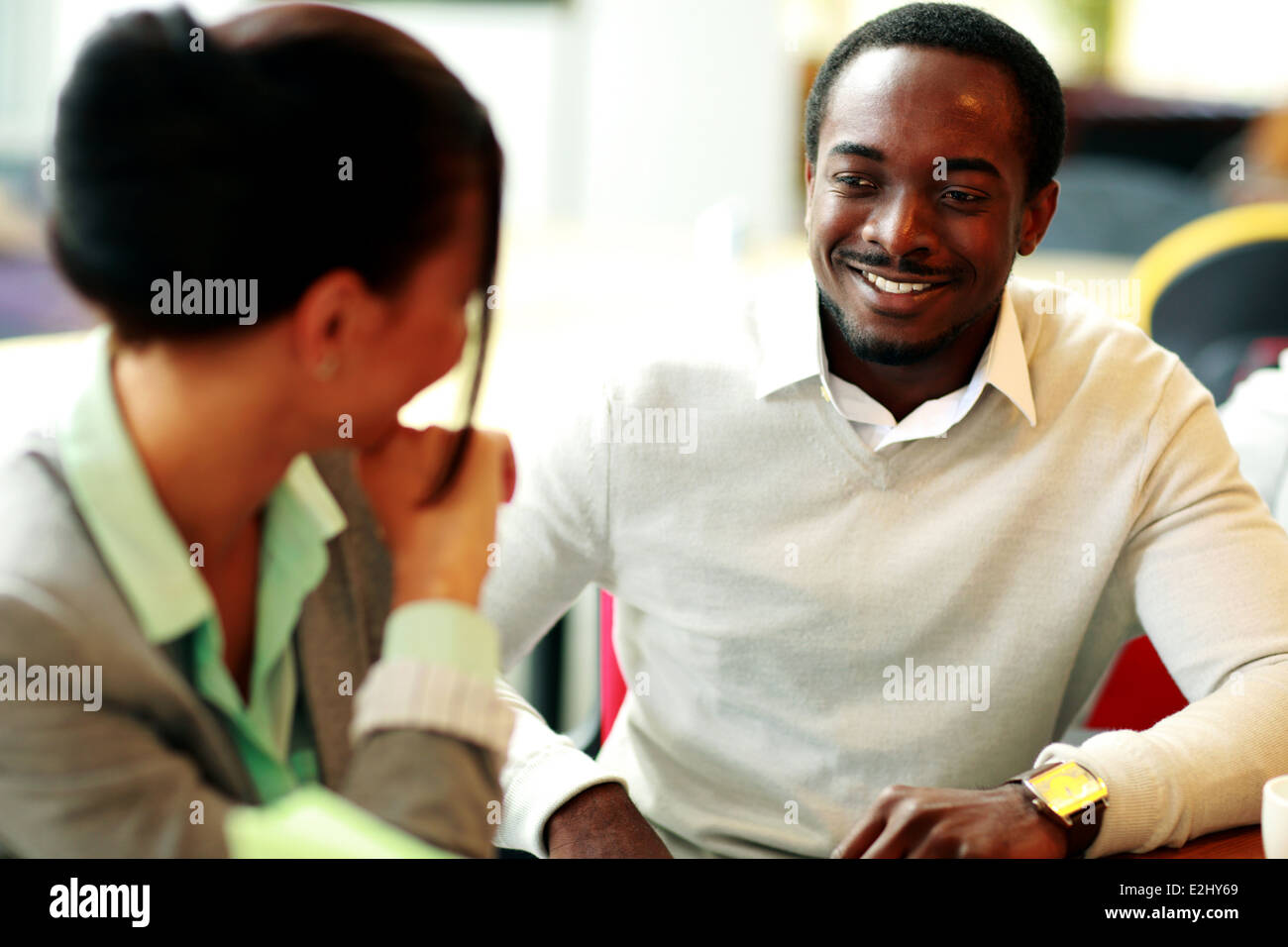 Happy young businesspeople working at office - Stock Image