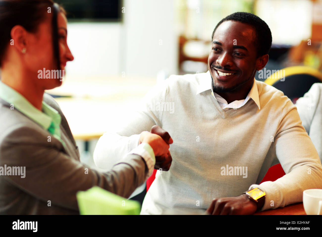 Portrait of a businesspeople handshaking - Stock Image