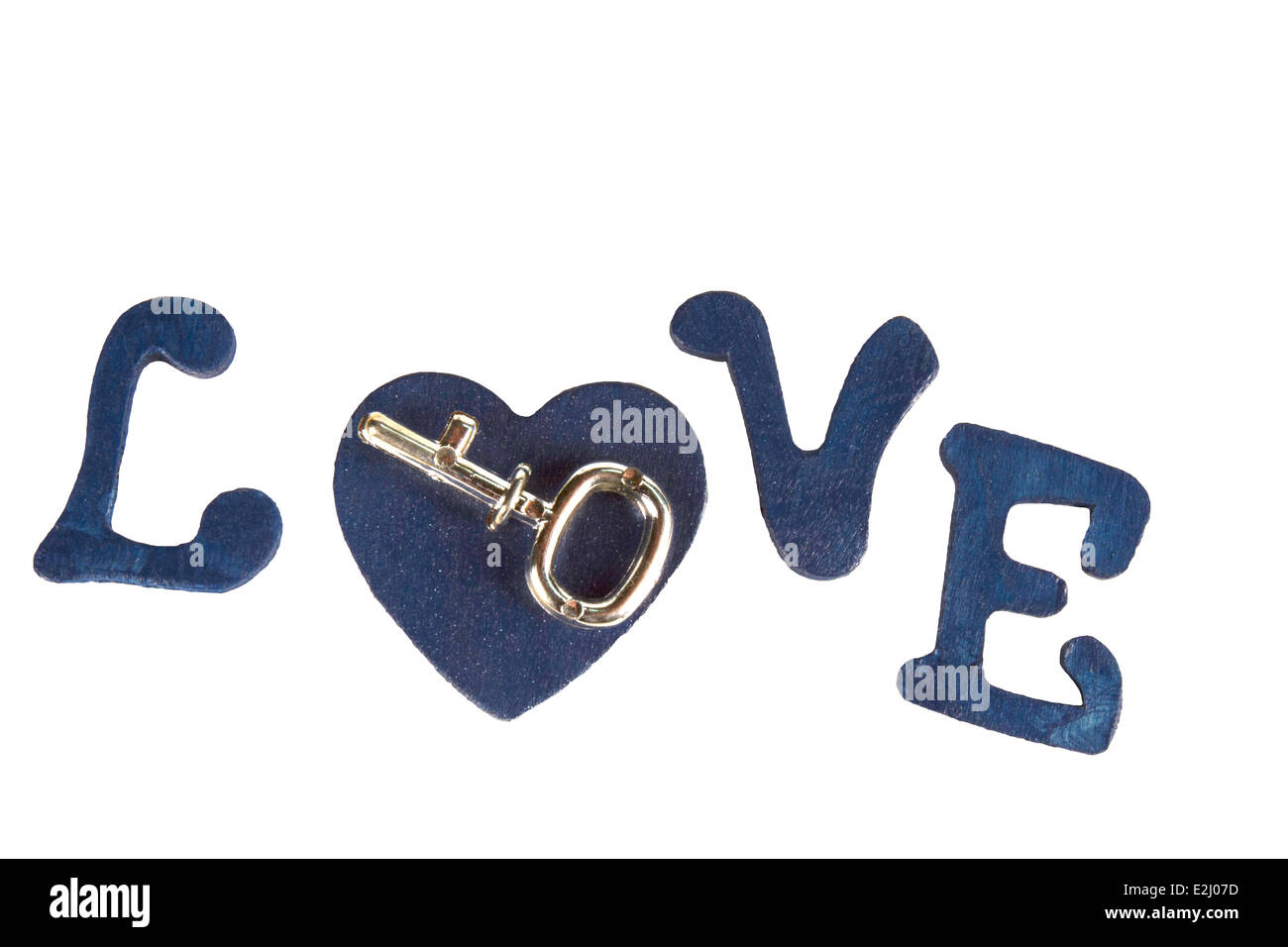 Key on a heart in the word LOVE spelled in wooden letters - Stock Image