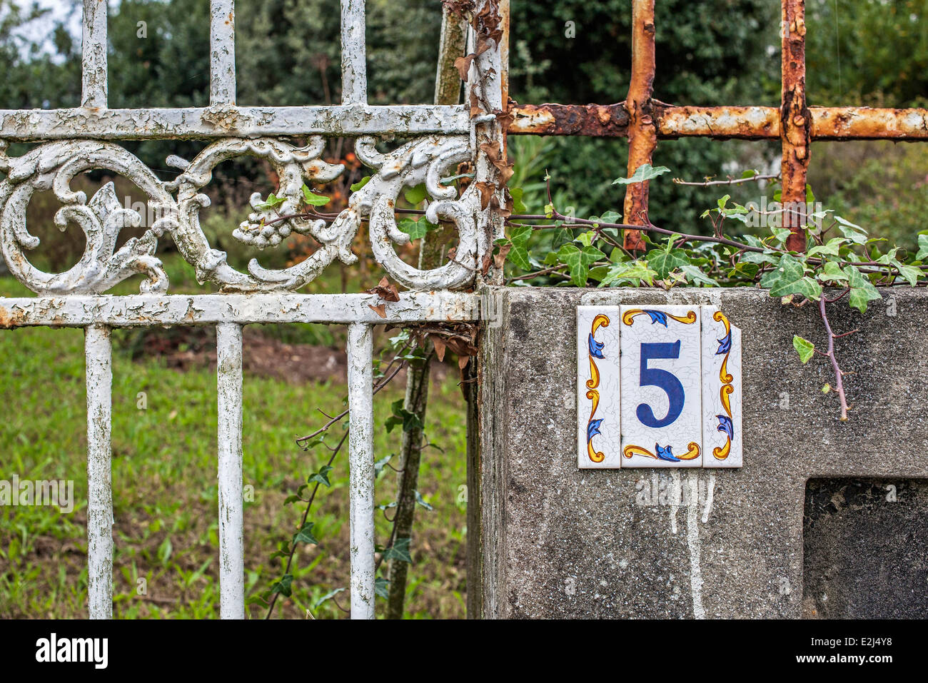 Number sign on rusty gate - Stock Image
