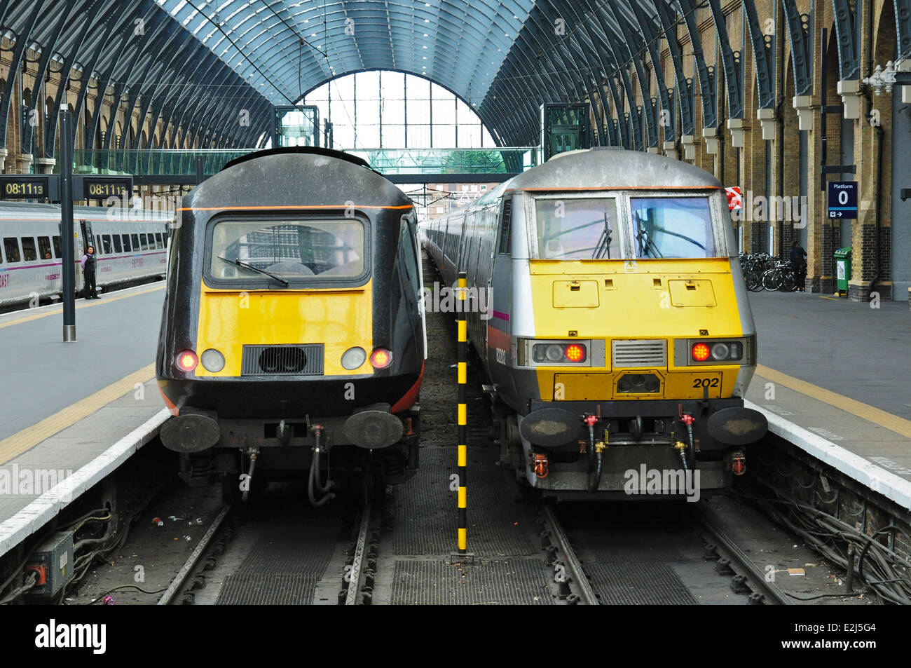 Inter City 125 diesel and 225 electric trains side by side at King's Cross railway station, London, England, UK Stock Photo