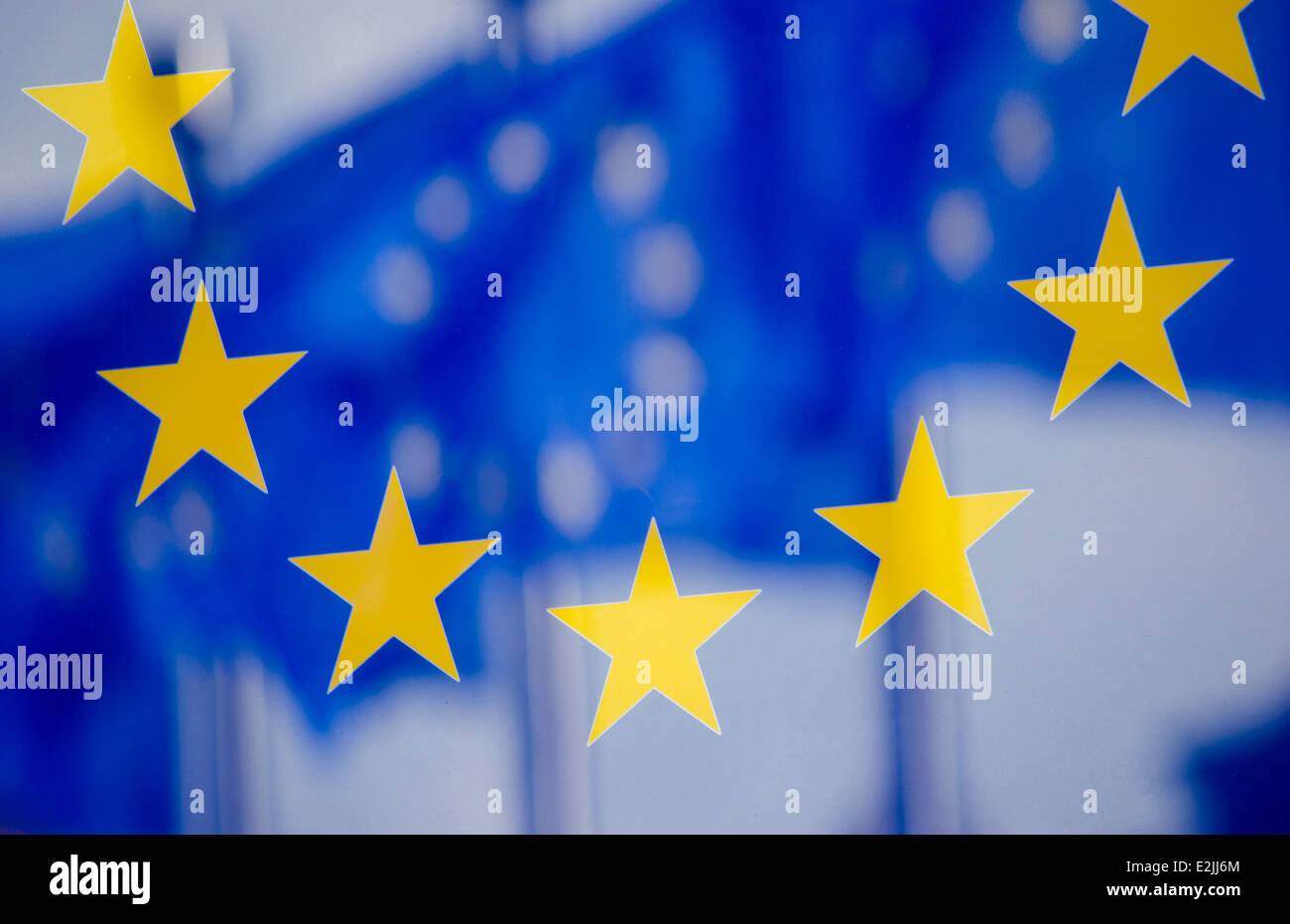 Reflection of UE flags in a panel on the wall of the European Commission building - Stock Image
