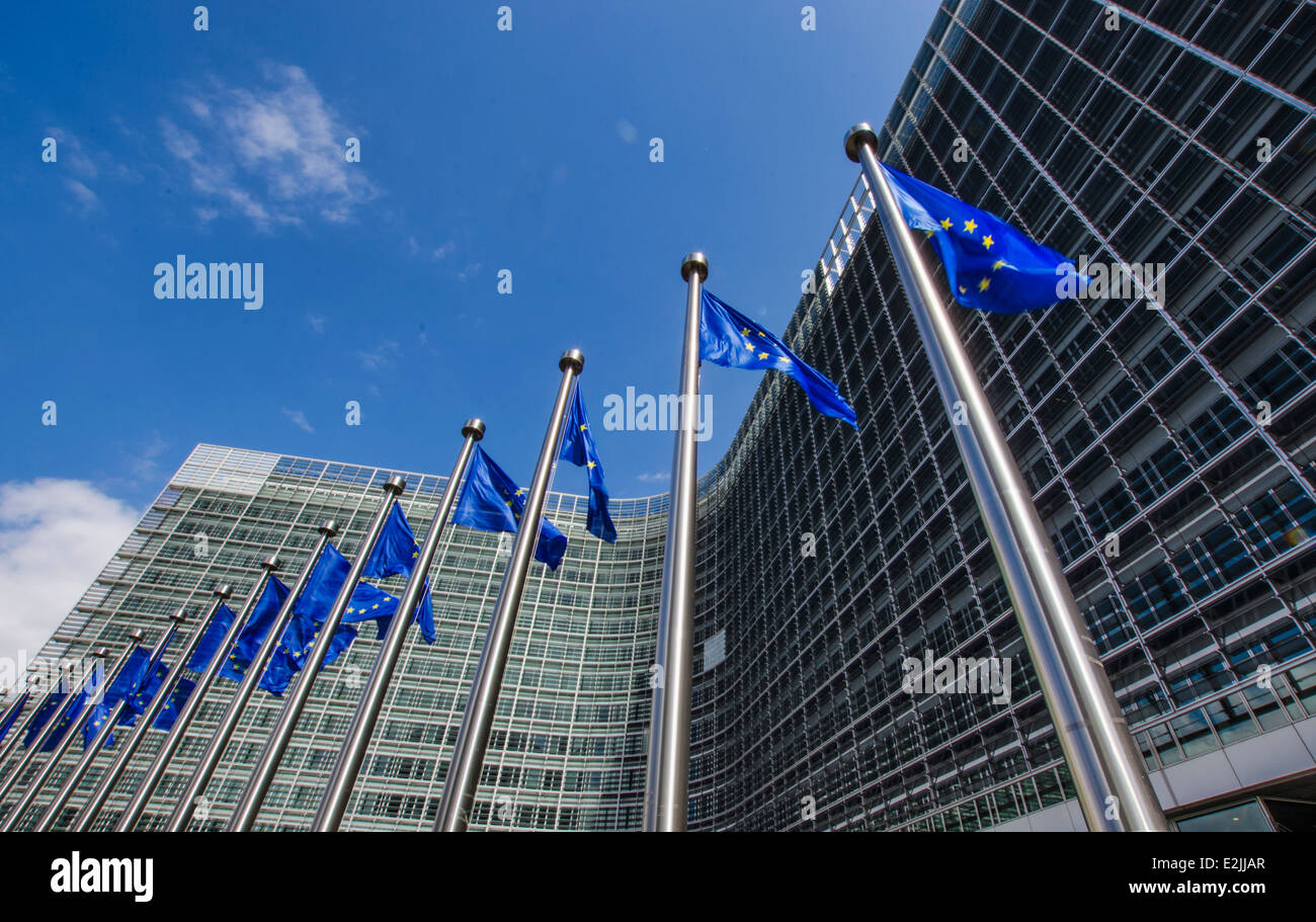 EU flags in front of European Commission in Brussels - Stock Image