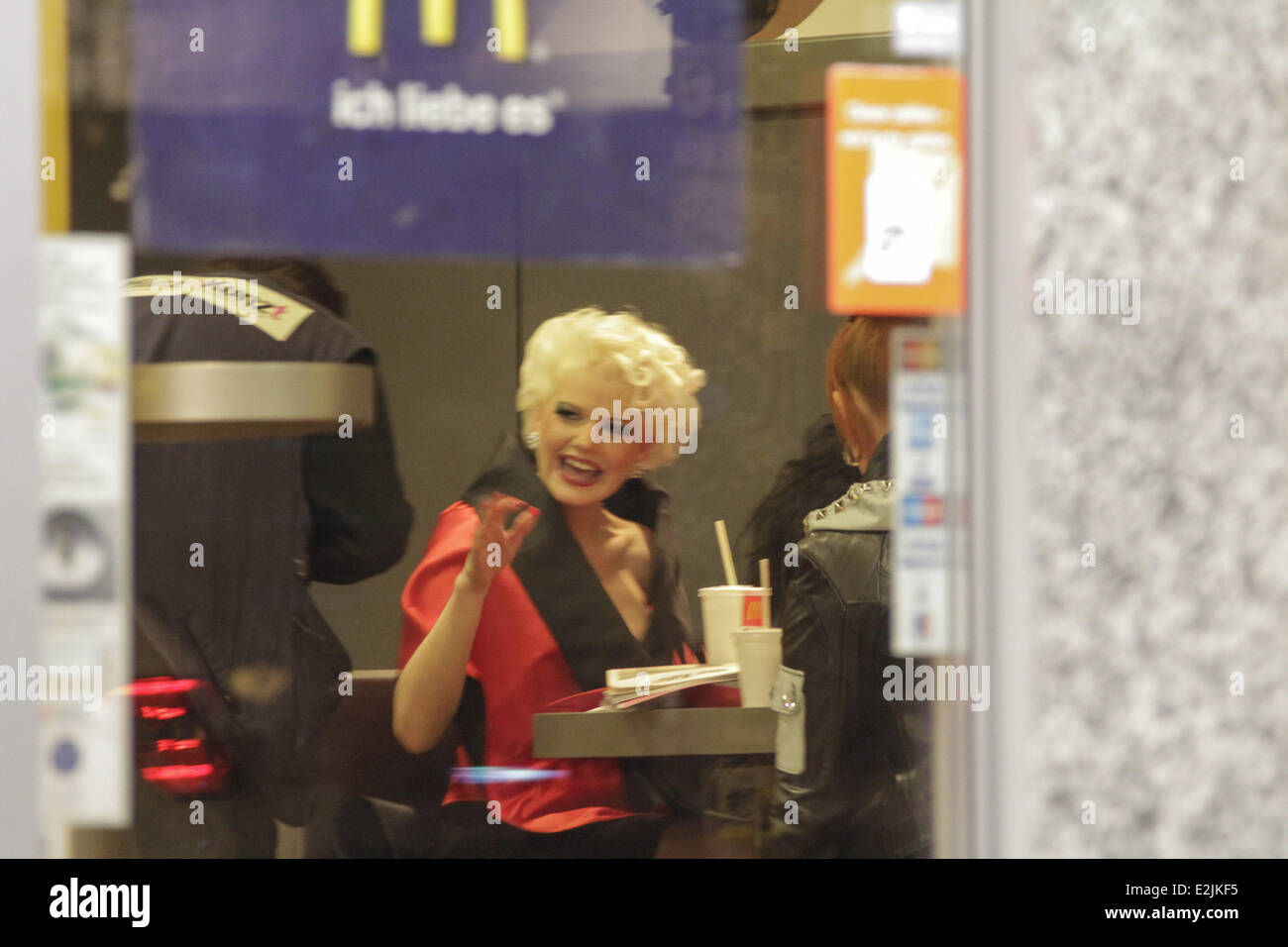 Melanie Müller buying a Hinz & Kunzt street paper at McDonald's on Reeperbahn street at 1.30am.  Where: - Stock Image