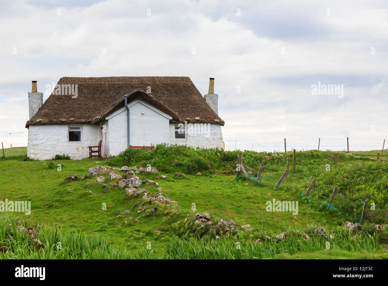 Youth Hostel in old thatched blackhouse cottage with whitewashed walls. Howmore South Uist Outer Hebrides Western Stock Photo