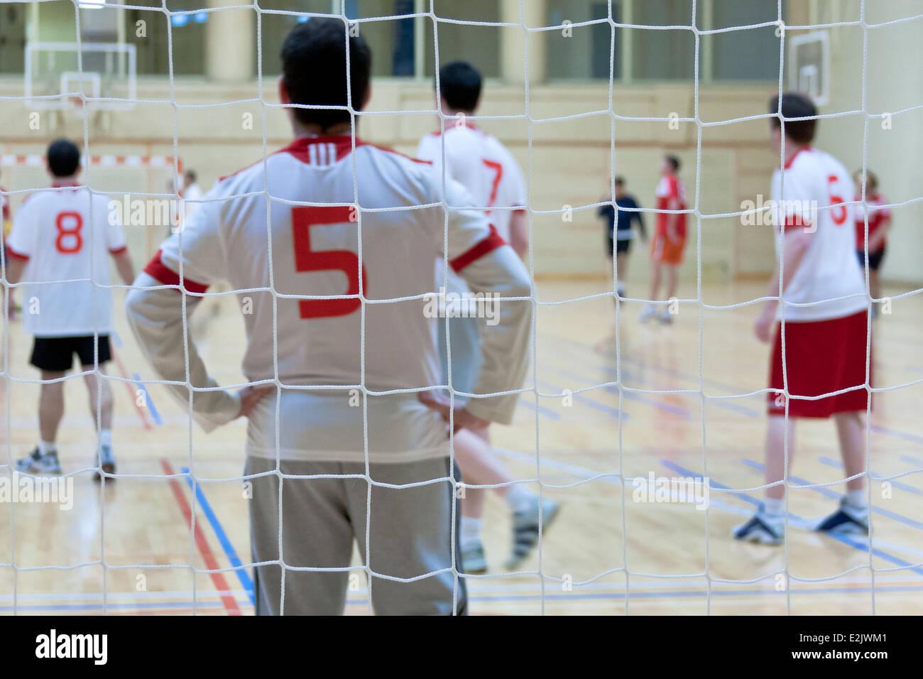 Behind goal of indoor team sport - Stock Image