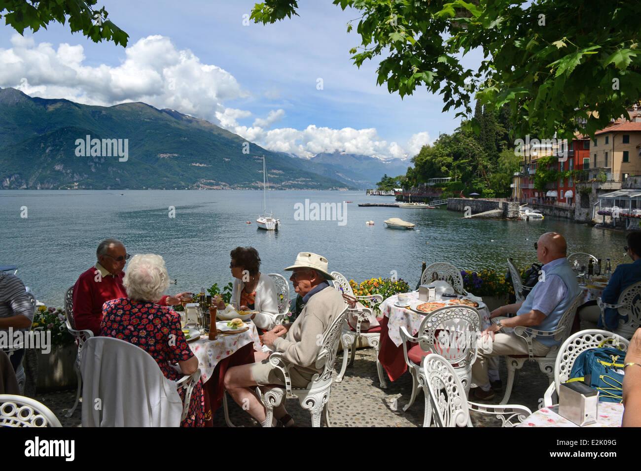 Lakeside dining at restaurant at Varenna on Lake Como Italy - Stock Image