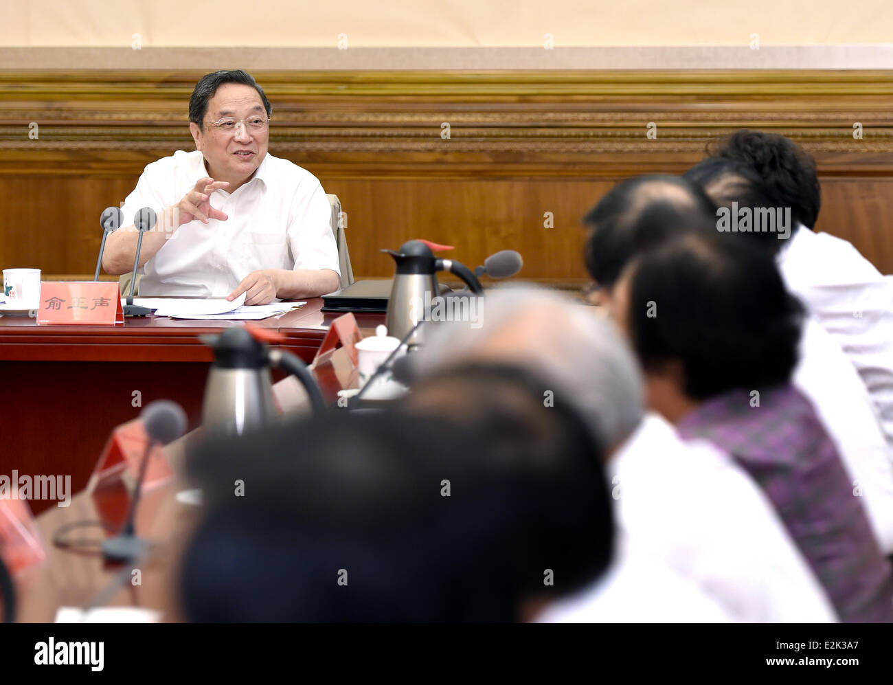 Beijing, China. 20th June, 2014. Yu Zhengsheng (L), a member of the Standing Committee of the Communist Party of - Stock Image