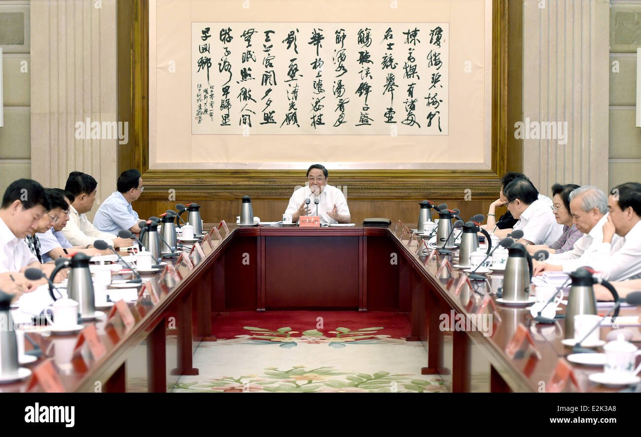 Beijing, China. 20th June, 2014. Yu Zhengsheng (C), a member of the Standing Committee of the Communist Party of - Stock Image