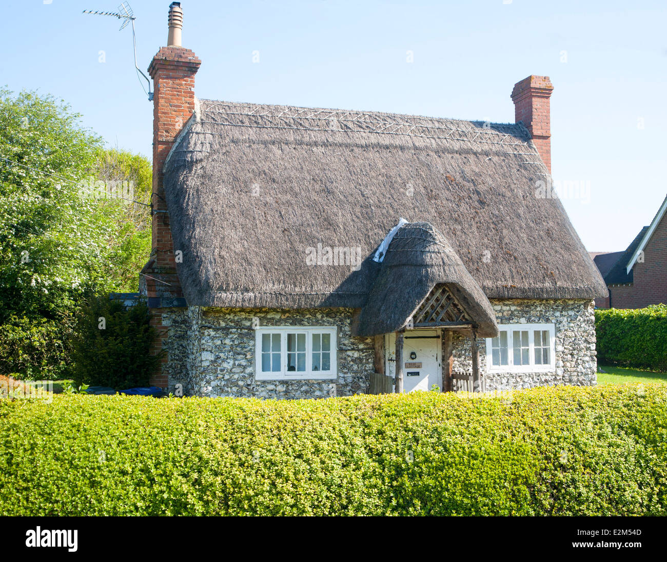 Pretty detached thatch and flint cottage Wilcot village, Wiltshire, England - Stock Image