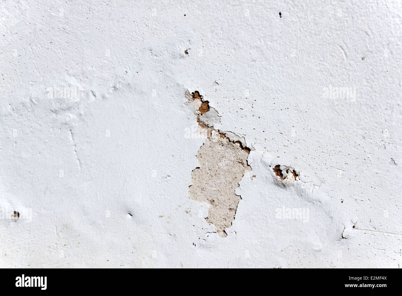 deterioration of exterior wall due to rising damp - Stock Image