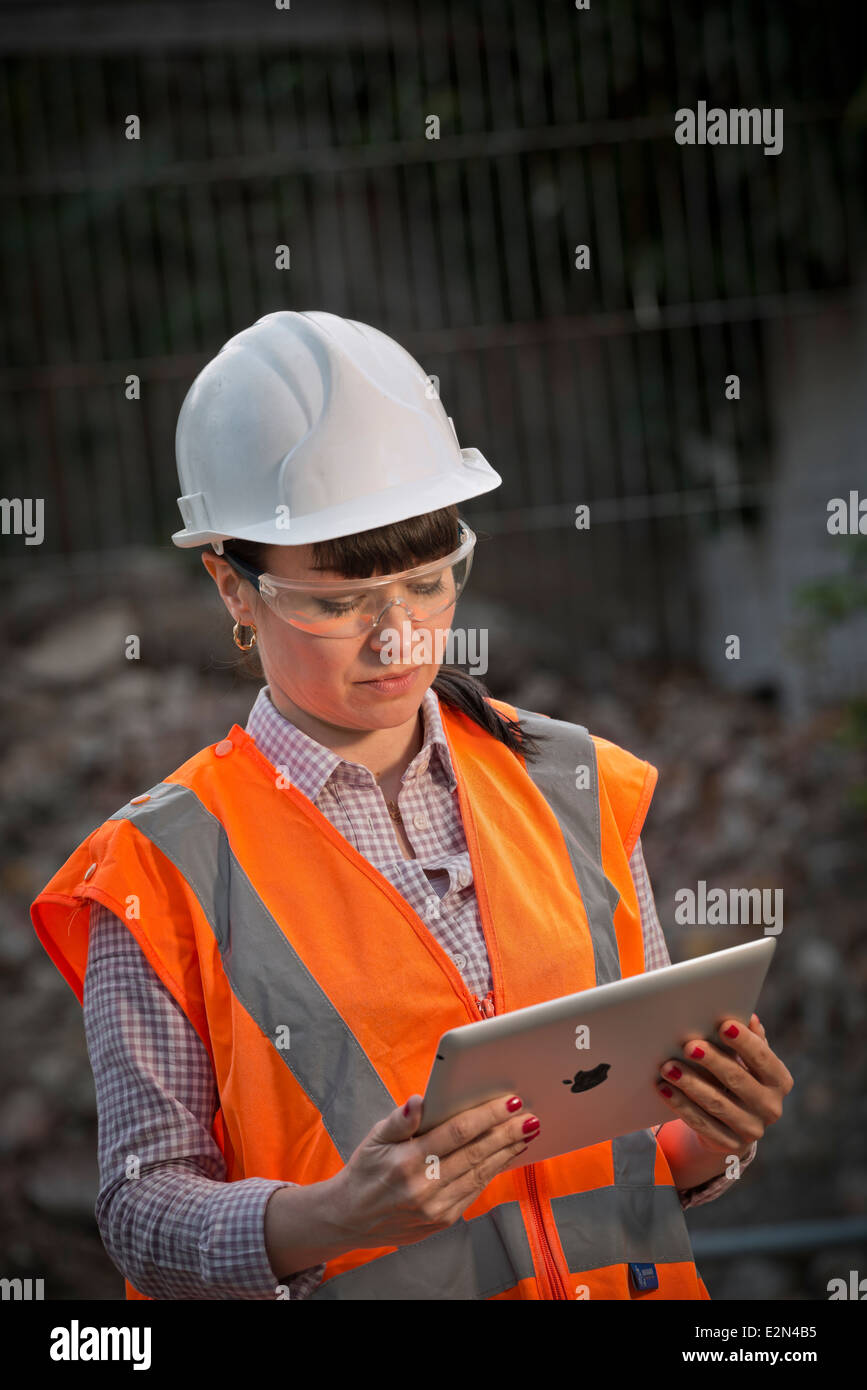 Female construction worker using an ipad Stock Photo