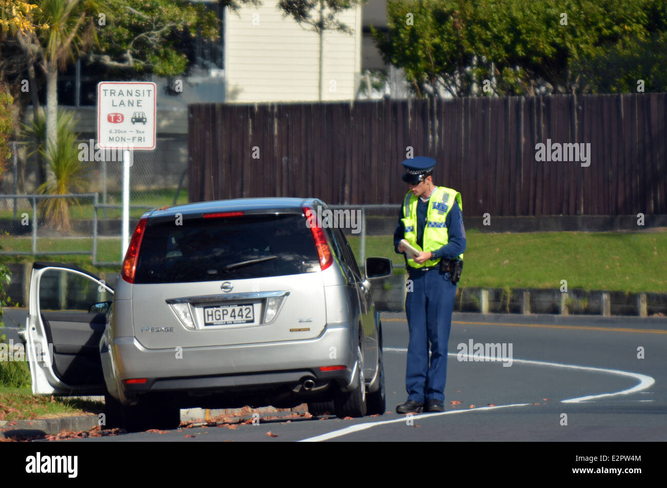 Traffic Police officer writing a traffic citation. - Stock Image