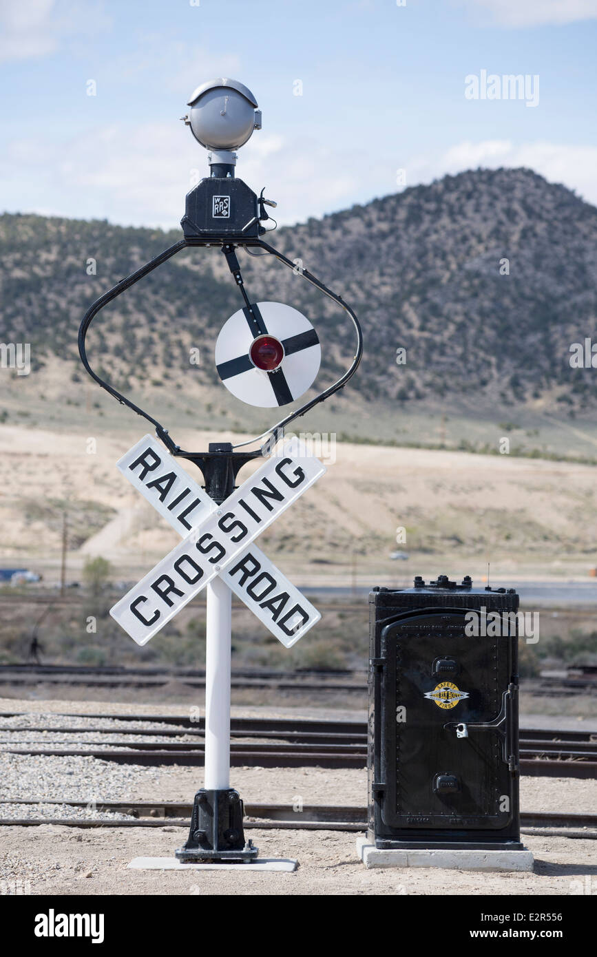 Restored vintage railroad crossing signal along the historic