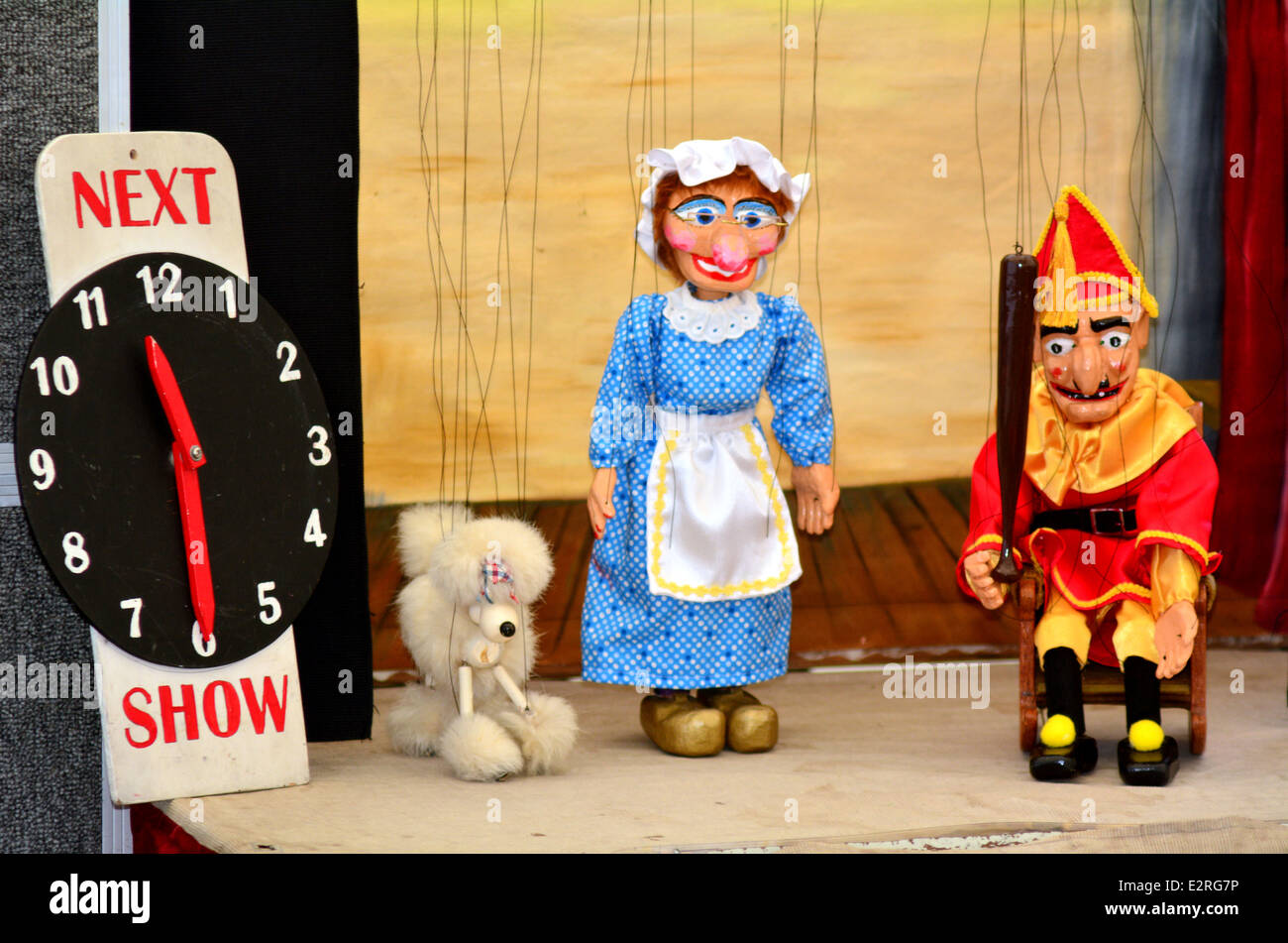 Puppeteer manipulates puppets during puppetry show - Stock Image