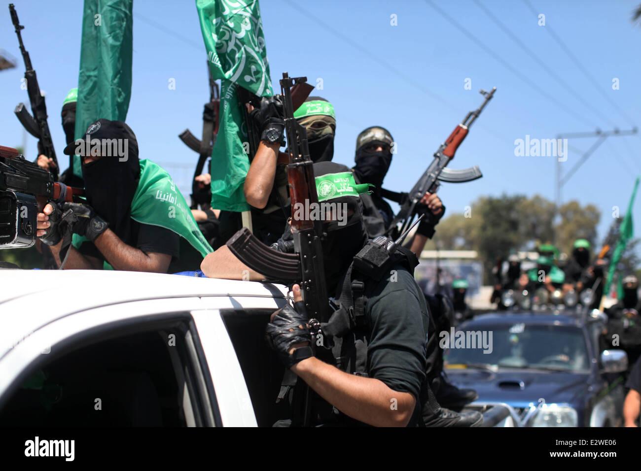 Gaza City, Gaza Strip. 21st June, 2014. Palestinian militants of the Ezzedine al-Qassam Brigades, Hamas's armed - Stock Image