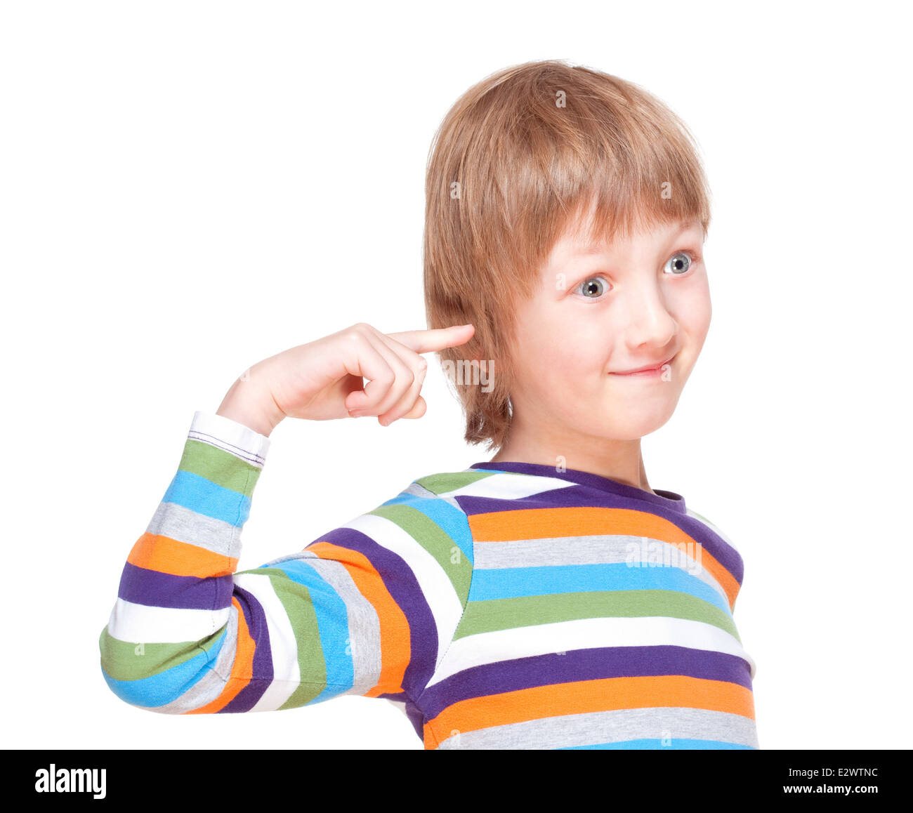 Boy in Colorful Shirt Pointing Finger to his Head - Isolated on White - Stock Image
